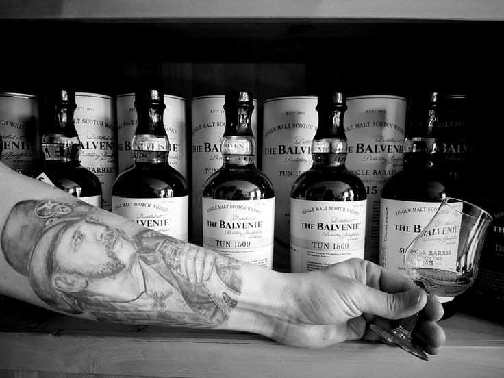 Lemmy Tattoo infront of Balvenie Whisky Collection