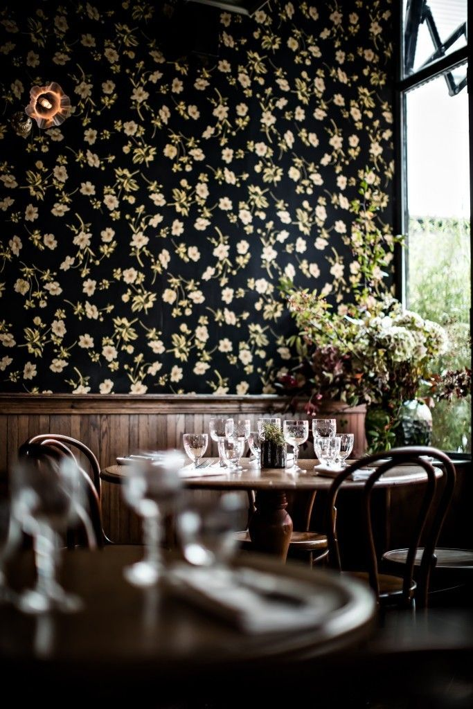 Hôtel Providence in Paris | the roughness of the wood paneling with the refined wallpaper and cafe Thonet chairs