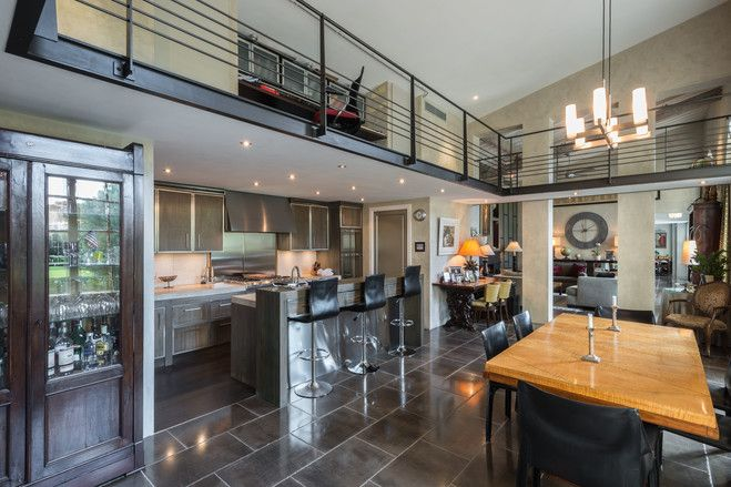 """The dining area has a small bar and a casual eating area. """"Because it is all open plan it is wonderful for entertaining and dinner parties,"""" says Mr. Fernie."""
