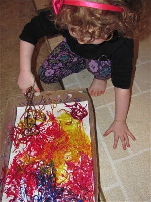 Painting with noodles - especially awesome for helping push kids with sensory issues.