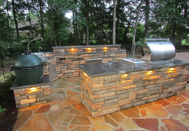 Outdoor Kitchen with built in lighting a big green egg and gas grill!