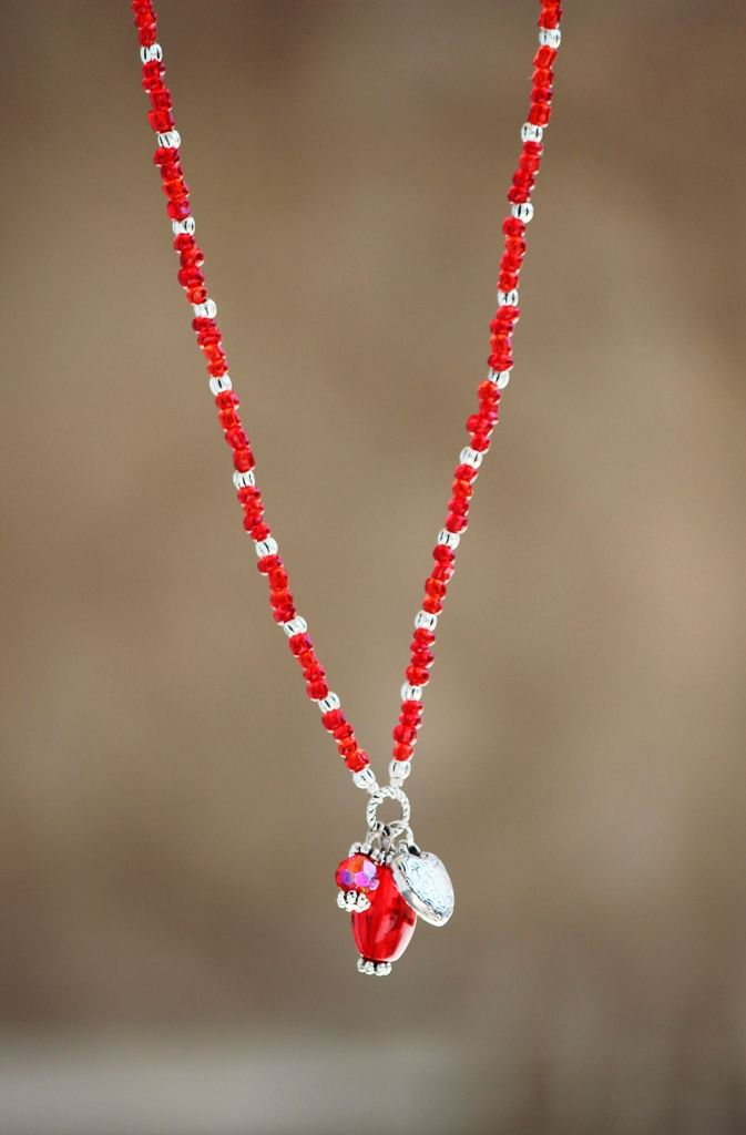 Red necklace with heart pendant made by HeartBeads. https://www.facebook.com/heartbeadsjewellery