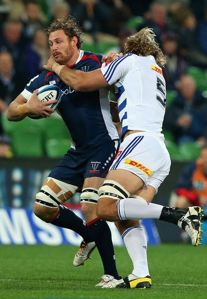 Scott Higginbotham of the Rebels is tackled by Andries Bekker of the Stormers during the round 14 Super Rugby match between the Rebels and the Stormers at AAMI Park on May 17, 2013 in Melbourne, Australia.