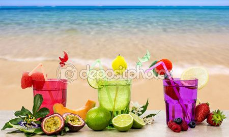 Exotic fruits cocktail over seashore background