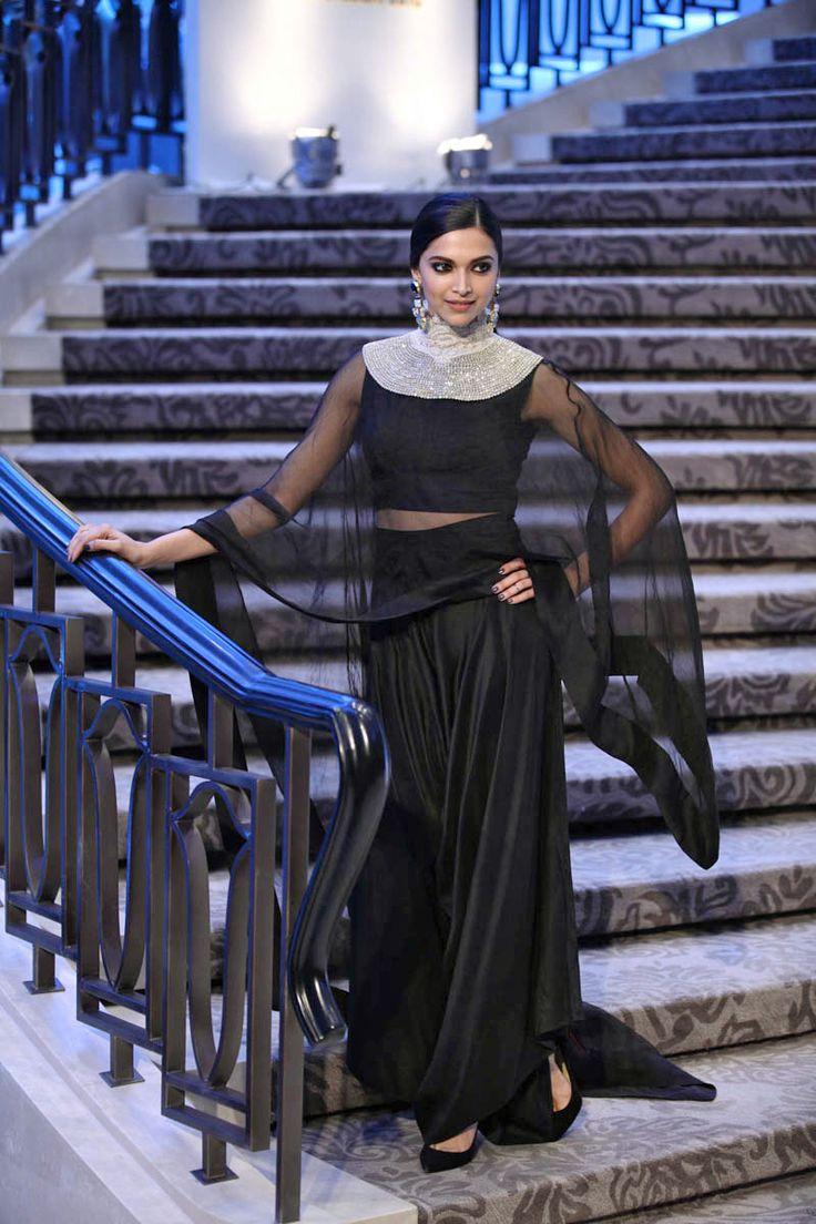 Deepika Padukone at Anamika Khanna Show at Lakme Fashion Week Resort 2015 in a Anamika Khanna ensemble. Her look included a simple black crop top and draped palazzo pants.