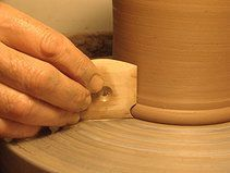 Van Gilder's Profiled Foot Rib http://www.clay-king.com/pottery_tools/van_gilder_tools.html