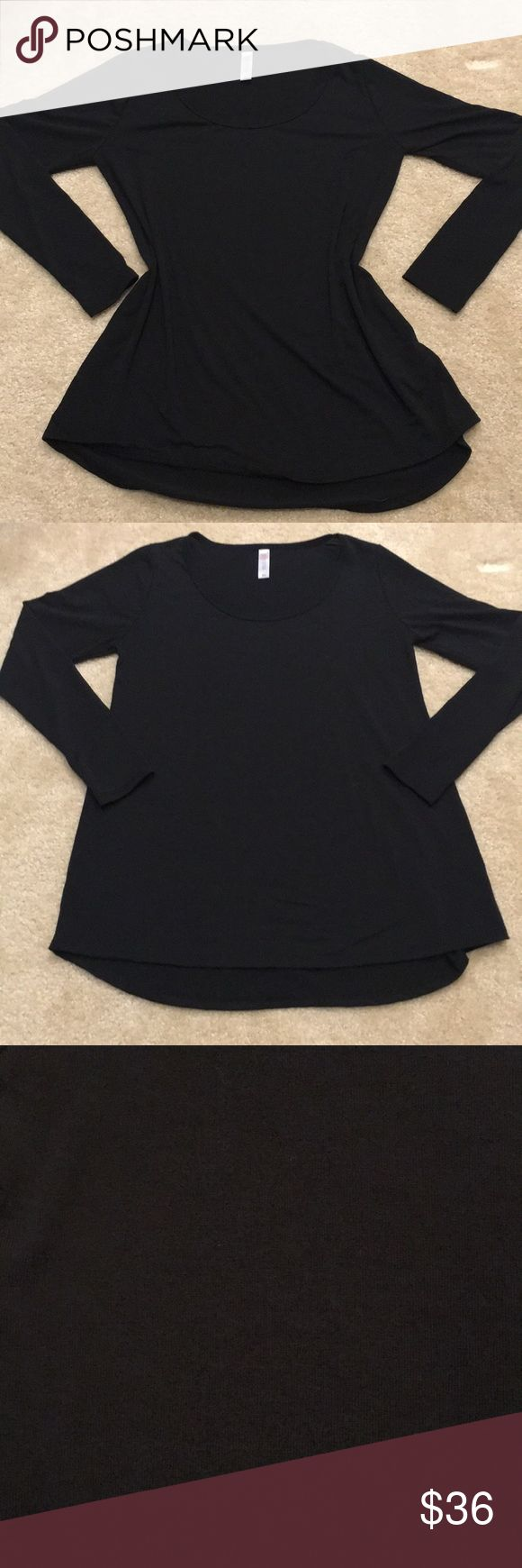 Like New! XS LulaRoe Noir Collection Lynnae Like New! XS LulaRoe Noir collection Lynnae. I've worn this ONE time (maybe a couple hours), but the shoulders are too tight for my liking. Immaculate condition! Smoke free home. Bundle more items and save. LuLaRoe Tops Tees - Long Sleeve