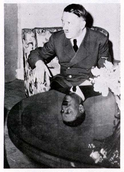 "Famous ""mirror table"" Hitler photo from 1942-43. Photo is attributed to Eva Braun, but it was taken in Berlin and there aren't that many pictures she took of Hitler there. She did film him in color in July, 1940 returning to Berlin after the fall of France. Considering this dizzying triumph, I bet his reunion with Eva packed a special punch that day. ""Confidence is sexy"" and all that. Picture first shown in Robert Payne's 1973 Hitler biography and dated to 1940, but is later. (via…"