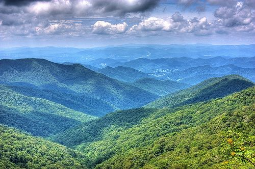 Craggy Gardens Visitor Center view - Milepost 364.6 at about 5,500-ft. on the Blue Ridge Parkway, about 20-miles north of Asheville, North Carolina ... a view of scenic I-26 is shown curving up a distant mountainside, slightly right of center near the horizon. | by sporadic on Flickr