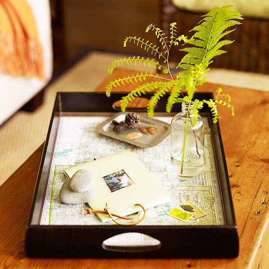 A tray is a helpful addition in any room. Personalize the gift with a map of your hostess's favorite vacation spot. Trim the map to the tray's dimensions and attach it with spray adhesive. Cover the map with glass for a long-lasting finish./