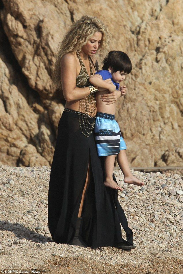 Mummy duties: Shakira was seen doting on her eldest son Milan on Thursday as she tried to ...
