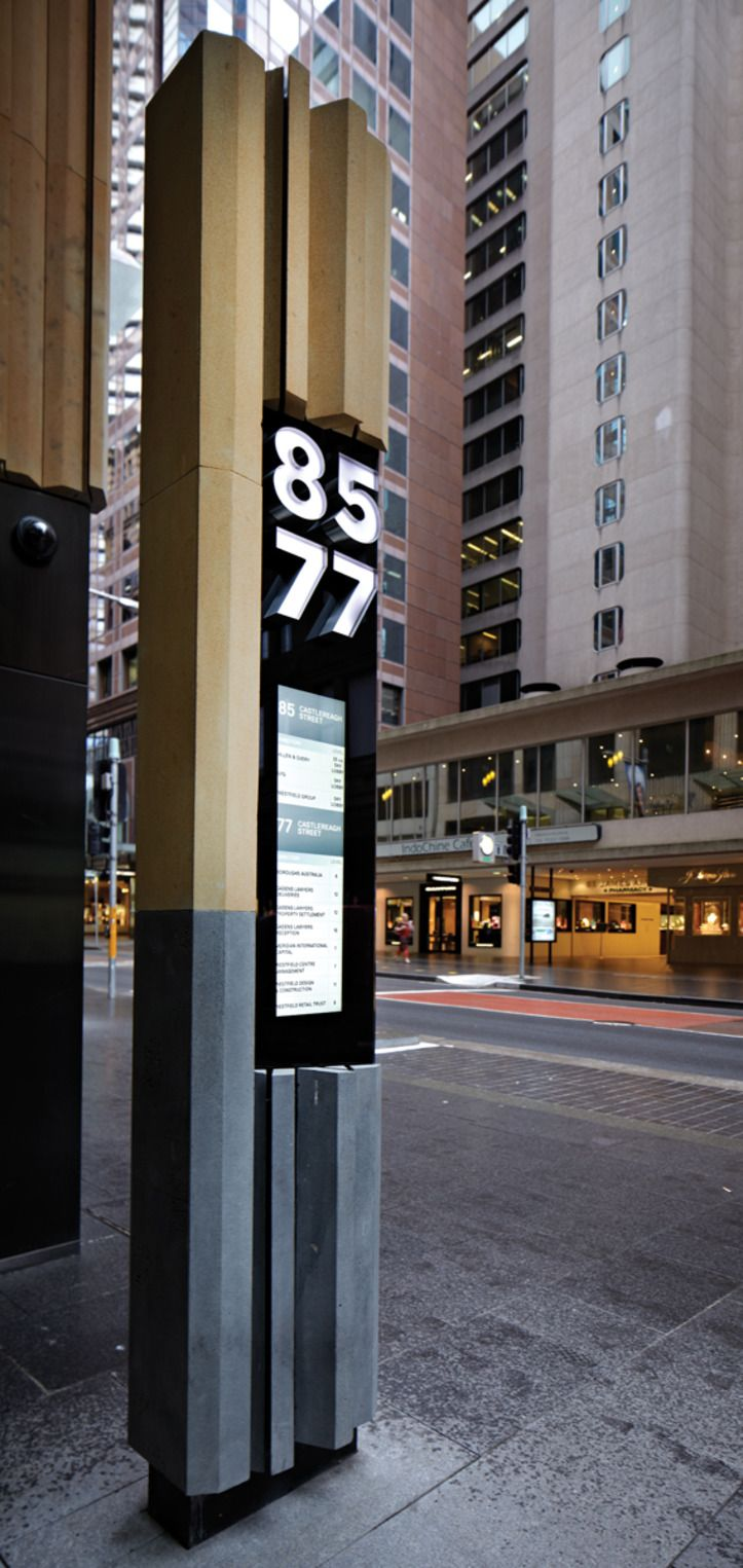 Seamlessly integrated and beautifully reductive signage and wayfinding solution for 2 business buildings in Sydney, Australia