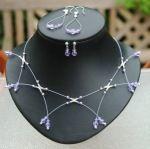 Maak een zwevend geregen sprietenketting met Swarovski kristal