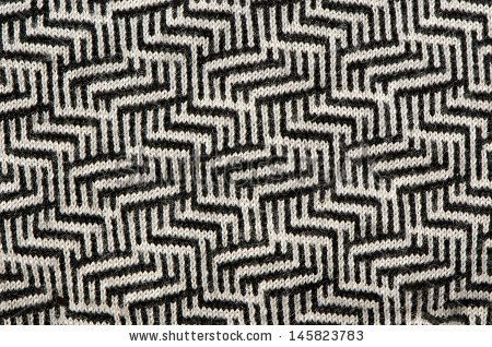 hand knit wool zigzag pattern texture black white backdrop.