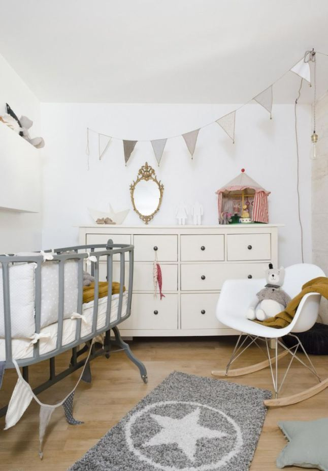 Beautiful white and grey nursery with an unusual grey crib.