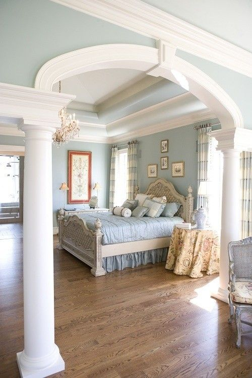 blue bedroom with crown molding details adding crown molding
