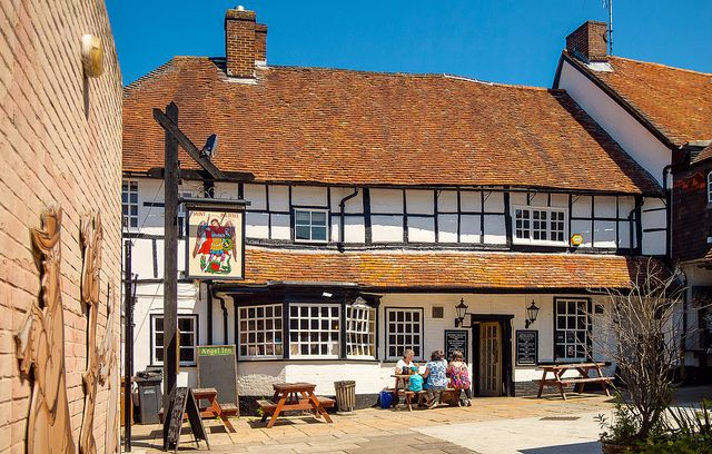 The 15th Century Angel Inn at Andover, Hampshire    The Angel is Andover's oldest inn, commissioned in 1445 when  Winchester College entered a contract with Richard Holnerst and John  Harding to build an inn on the site following a disastrous fire which  destroyed much of the town. All the records survive in the College  archives and the Angel (despite the brick cladding) is one of the best  half-timbered buildings in Hampshire.