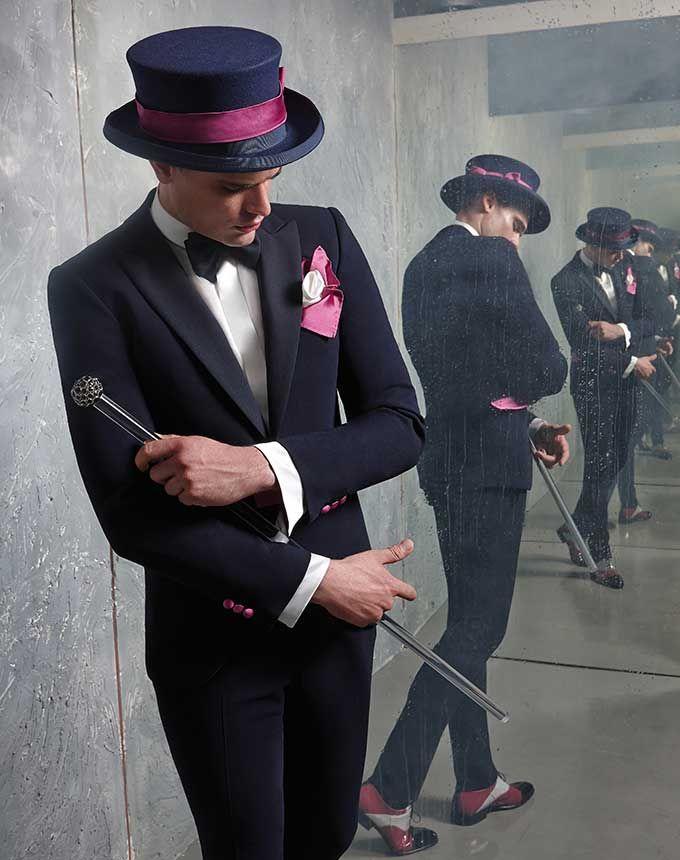 Lo smoking è da sempre l'abito d'eleganza per eccellenza. Cleofe Finati propone un modello sfiancato che mantiene la raffinatezza tradizionale e s'impreziosisce di toni che richiamano l'orchidea,  simbolo di armonia e amore.