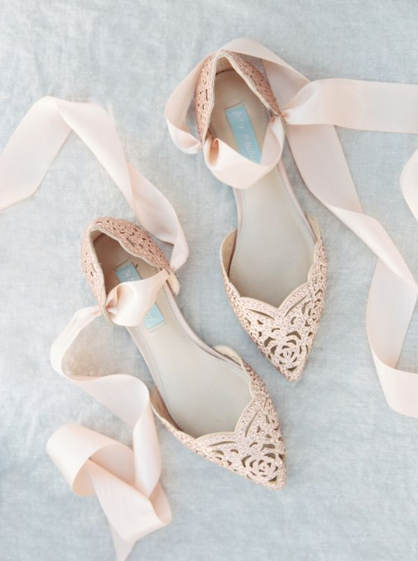 Ballet flats with a gorgeous twist. Pointy toe, satin ribbons, and intricate cut outs