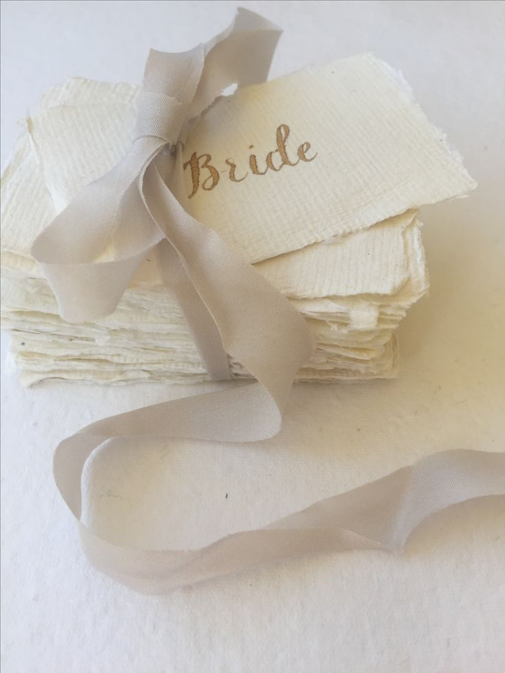 Elegant and romantic, gold calligraphy on cream handmade paper. Perfect place cards or escort cards.