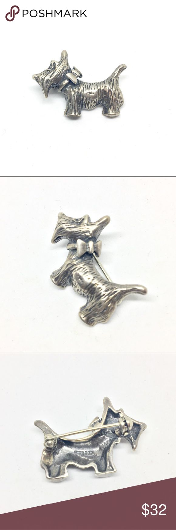 "Sterling Silver Vintage Scottie Dog Pin True vintage 925 sterling silver Scottie dog brooch pin. Pictures the profile of the dog wearing a bow collar. Textured with fur detailing all over. Signed 925 on the back. Pin is in perfect condition. Measures 1 1/4"" wide by approximately 3/4"" tall at tallest point. Vintage Jewelry Brooches"