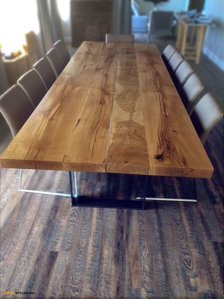 Solid French oak dining table 66m thick with stainless steel centre joining strip. Legs are from solid 80x12mm stainless steel.