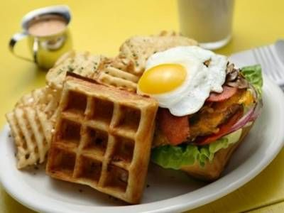 Breakfast Burger: Delicious for breakfast, lunch or dinner. This burger is absolutely decadent: Savory waffles act as bread while a beef burger is topped with maple mayo, bacon, and a fried egg.