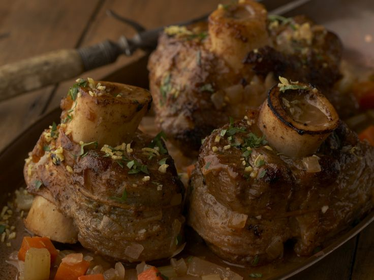 Osso Buco from FoodNetwork.com u can use pork shoulder, red wine and beef broth garlic too. Can be made in a pressure cooker!