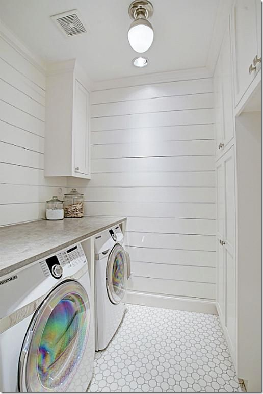 Shiplap and mosaic tile in the laundry room. Cement counters to match flooring in main basement room.