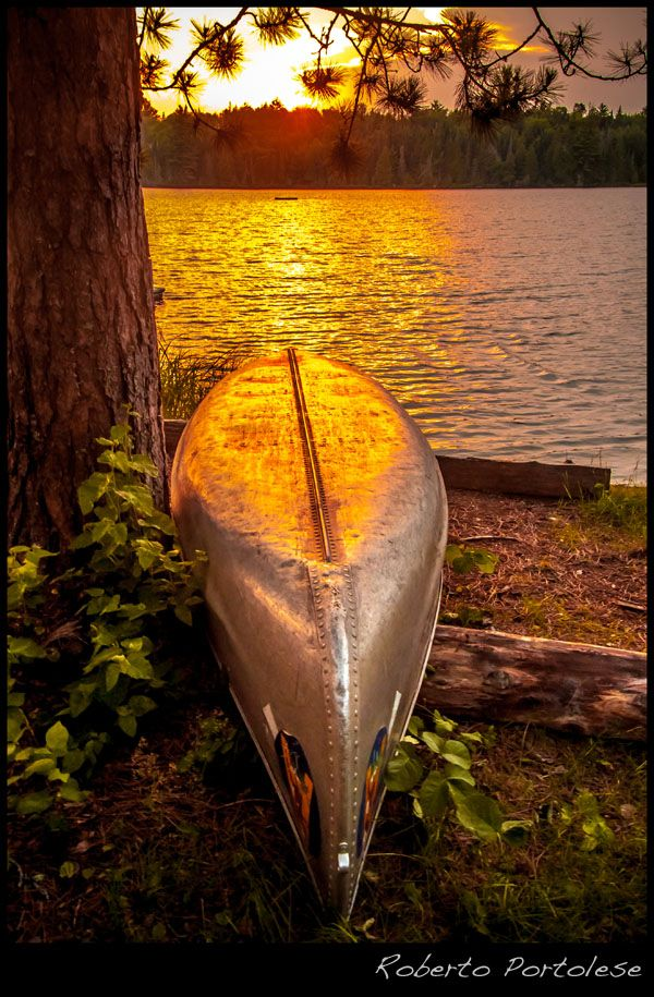 At the end of the day, canoe at sunset in Algonquin Park, On, Canada