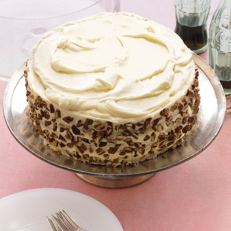 Beneath this towering yet unpretentious appearance lies multiple layers of moist, mildly spiced cake that are flecked with carrots and pecans and enveloped by a generous coating of cream cheese frosting.