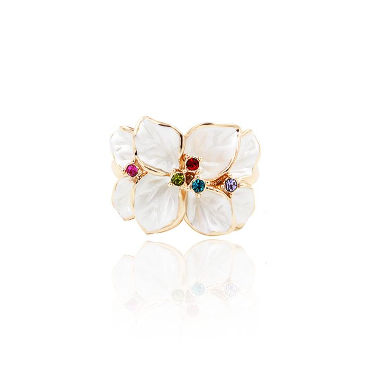 "Sydney. Floral cocktail ring with sparkling crystals. Décor length: 1.9cm (.7"") Décor Width: 1.5cm (.6"")"