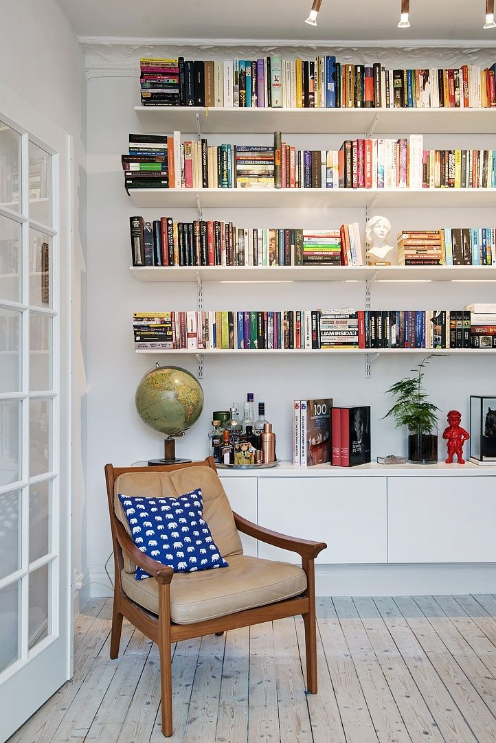 Wall hung sideboard and bookshelves. Perfect solution for the living room! This could also work as a media wall. Photo from a Scandinavian styled Gothenburg apartment.