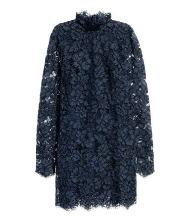 Dark blue. Short, fitted dress in lace. Small stand-up collar, long sleeves with cuffs and covered buttons, and covered buttons at back of neck. Concealed