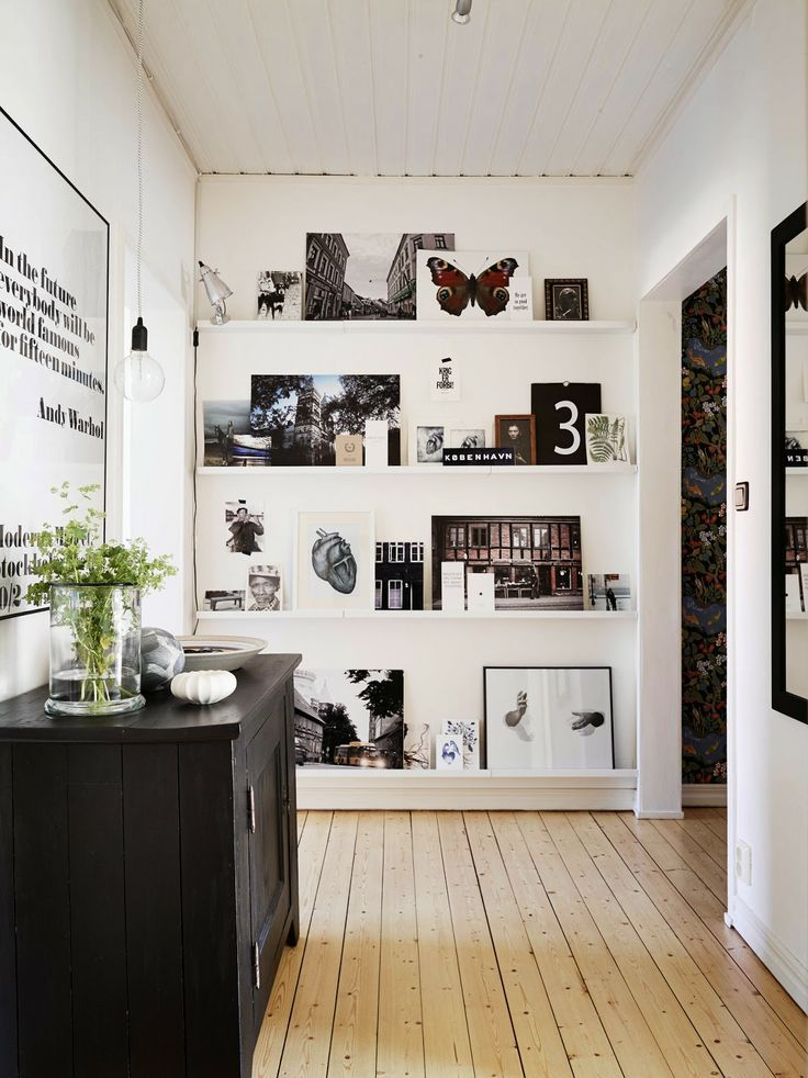 sneak some thin gallery wall shelving into the end of a hallway // #styling