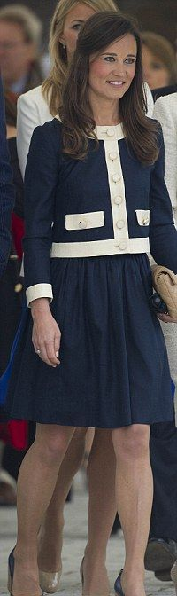 Kate's sister rode on the Queen's boat during the Jubilee-timed Pageant on the Thames wearing a navy Orla Kiely sweater with white piping and gold buttons over a matching ink blue dress. She added patent Jaeger wedges to complete her nautical look.
