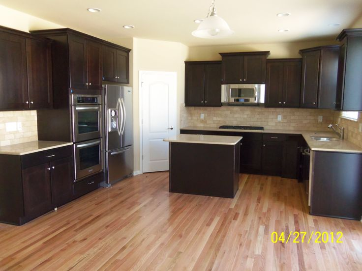 Merillat tolani maple staggered cabinets in kona denova for Merillat cabinets