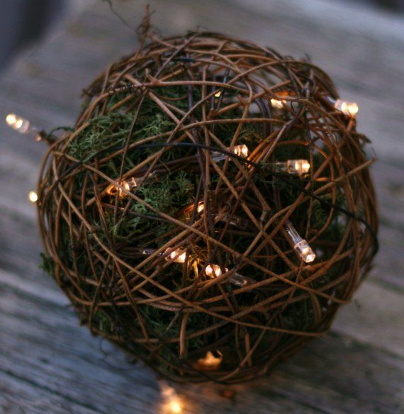 love these #pomanders with moss and white lights inside