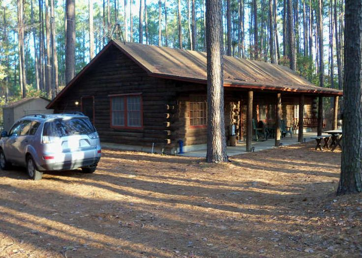 log cabin nestled in the pine trees of east texas just