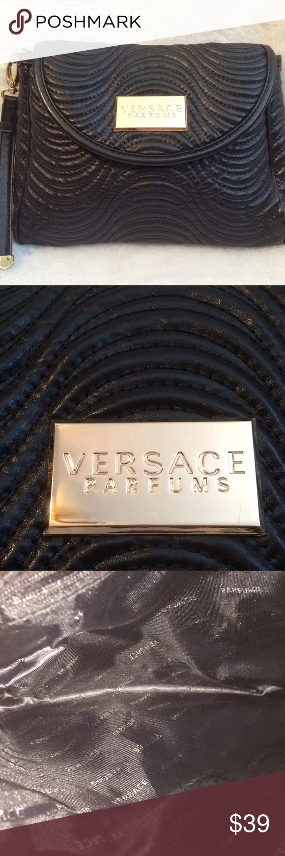 Versace Parfums Black Bag Versace Parfums Black Bag with Optional Strap. Gold Hardware. In like new condition. It maybe used as a handbag/clutch or a very nice makeup bag. Versace Bags Cosmetic Bags & Cases
