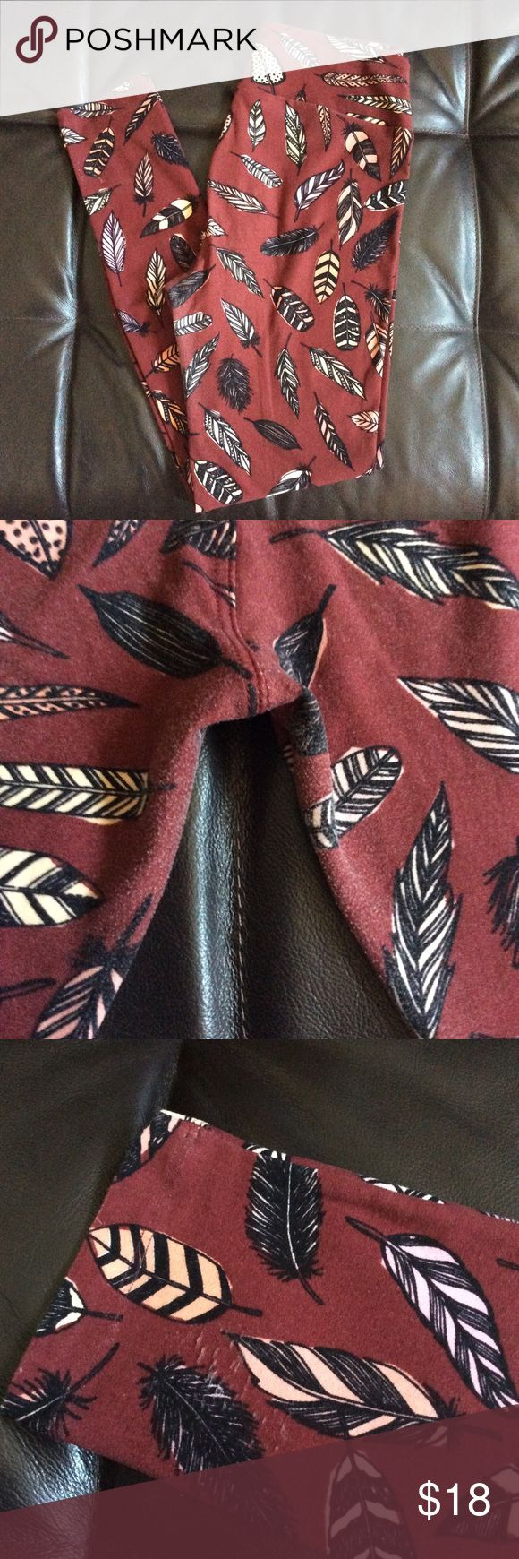 LulaRoe OS Leggings Feathers LulaRoe OS legging brown brick tone with feathers. 2nd pic (crotch shot). 3rd pic (minor pull on bottom leg). 4th pic (minor pull on bottom leg). Wear with boots so pulls won't be seen. Washed per LulaRoe instructions. Price is firm. LuLaRoe Pants Leggings