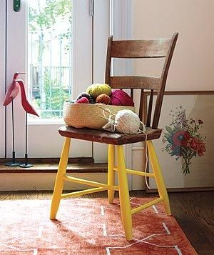 Give the seen-better-days legs of a wooden chair a fresh coat of paint, then use the chair as a side table to hold books, throw pillows, an extra blanket, or even your knitting.