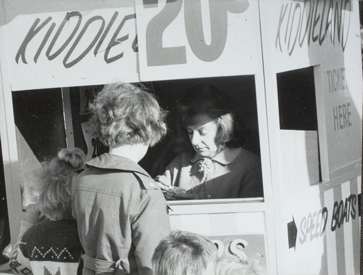 Children Buying Tickets at Kiddieland Ticket Booth, Royal Melbourne Show, Ascot Vale, 1972. - Museum Victoria