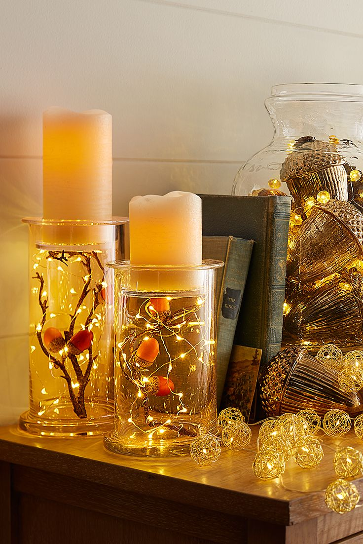 Gather some glow with one-touch mood lighting from Pier 1. With mini LEDs strung along shapable filament, our signature Glimmer Strings® add character to mantels, tables, wreaths and centerpieces. Pair them with our Deco Wick™ flameless pillars, which boast a melted mouth and burned wick like real candles.