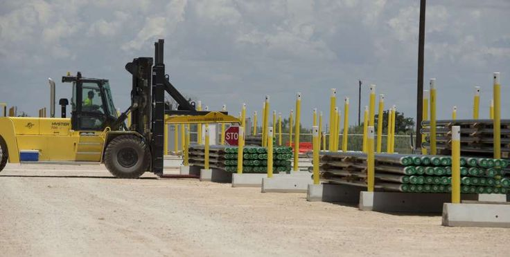 Large Hyster front end loaders are able to load more than 35,000 lbs. of pipe at a time in the Tenaris yard. Tuesday 06-28-16 Tim Fischer\Reporter-Telegram Photo: Tim Fischer