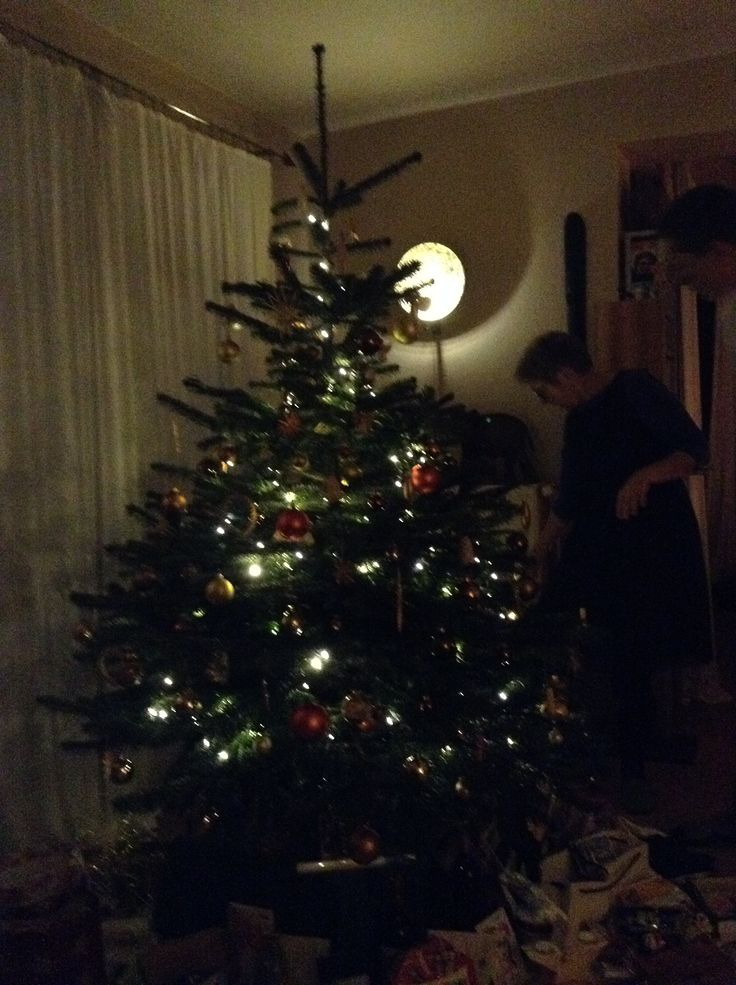 Christmas tree decorating in a lovely house in Germany
