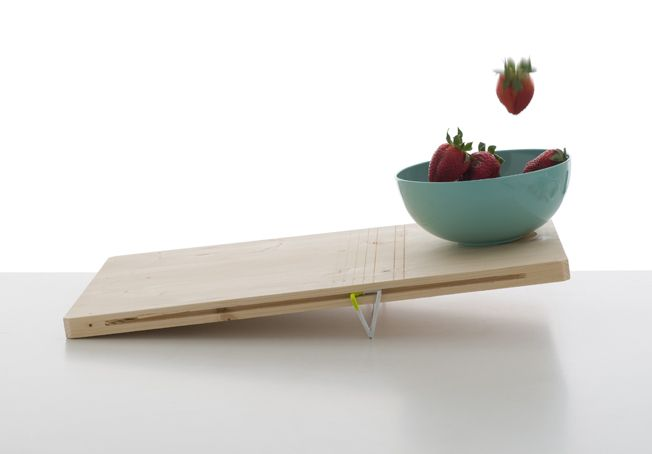 Balanced is a minimalist design created by France-based designer Pierre-Francois Dubois. These two cutting boards playfully integrate a scale into the design of the traditional cutting board. The first allows the user to adjust the scale to determine weight, while the other board is used to counter-measure weights of two different objects. (2)