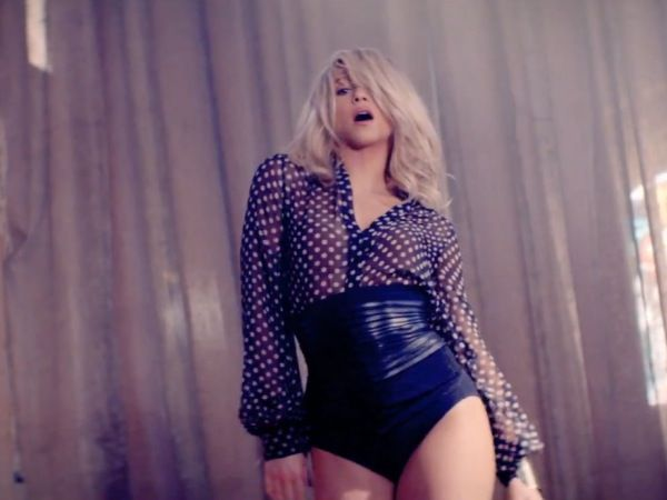 Love the shirt...would look great with a long navy skirt.  From Shakira's 'Addicted To You' video