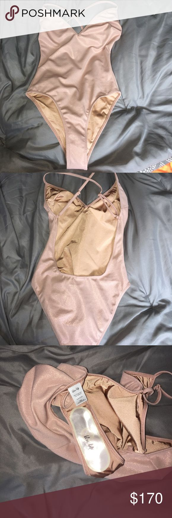 Blue life bikini & black one piece Open back nude 1 piece. Never worn brand new! Completely SOLD OUT!! Throwing in another one piece! 2 for 1 price. The black is brand new unbranded. If your interested I can work with u on the price Blue Life Swim One Pieces