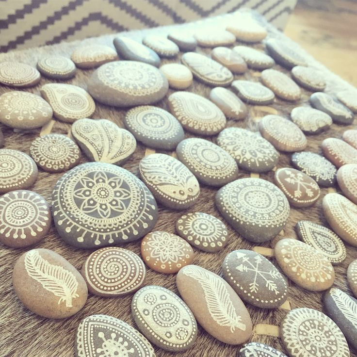 Hand painted, henna inspired ocean pebbles - measuring 2-5cm in size and available in pouches of 40-50. #handpainted #paintedstones #henna #mandala #bohemian #bohowedding #bohemianhome #bohemiandecor #bohemianwedding #pebbles #boho #homedecor #weddingdecor #decor #interiordesign #wildminds #capetown #southafrica
